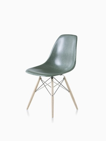 An Eames Molded Fiberglass Side Chair with a dowel base and dark green seat. Select to go to the Eames Molded Fiberglass Chair product page.