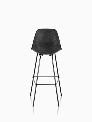 Black Eames Molded Fiberglass Stool, viewed from the rear.