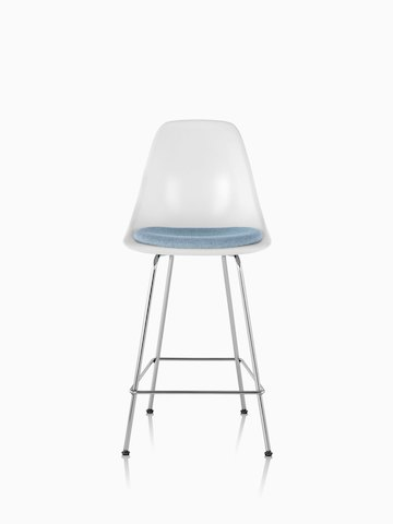 White Eames Molded Fiberglasss Stool with a light blue seat pad, viewed from the front.