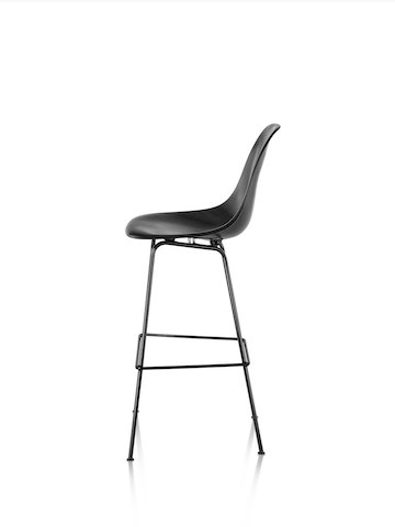 Profile view of a black Eames Molded Fiberglass Stool.