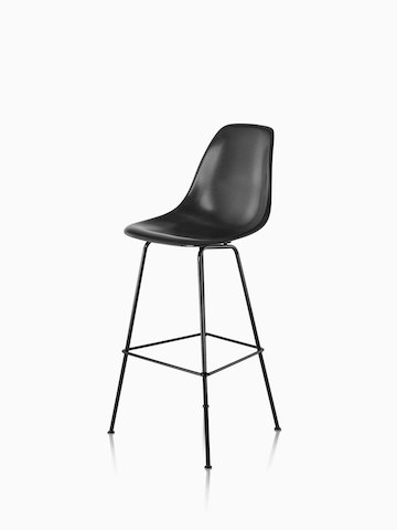 Black Eames Molded Fiberglass Stool, viewed from a 45-degree angle.