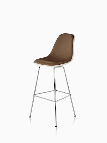 White Eames Molded Fiberglass Stool with brown upholstery, viewed from a 45-degree angle.