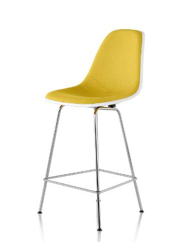White Eames Molded Fiberglass Stool with yellow upholstery, viewed from a 45-degree angle.