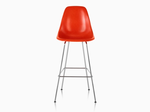Upper half of a red Eames Molded Fiberglass Stool, viewed from the front.