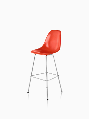 Red Eames Molded Fiberglass Stool. Select to go to the Eames Molded Fiberglass Stool product page.