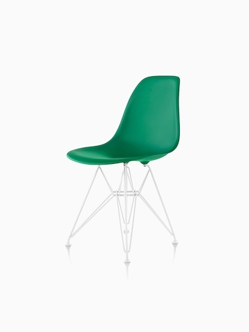 Green Eames Molded Plastic side chair with a wire base, viewed from a 45-degree angle.