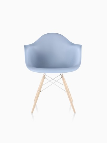Light blue Eames Molded Plastic armchair with dowel legs, viewed from the front.