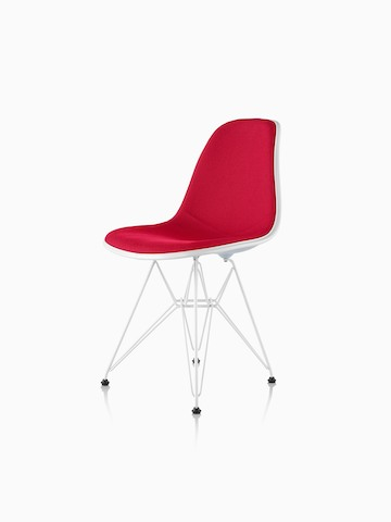 Red upholstered Eames Molded Plastic side chair with a wire base, viewed from a 45-degree angle.