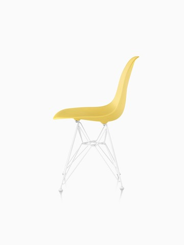 Yellow Eames Molded Plastic side chair with a wire base, viewed from the side.