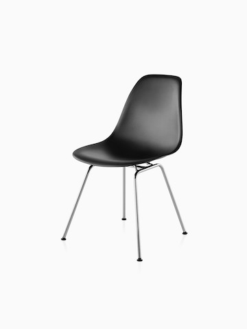 Four-leg version of a black Eames Molded Plastic side chair, viewed from a 45-degree angle.