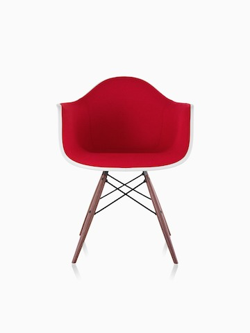 Red upholstered Eames Molded Plastic armchair with dowel legs, viewed from the front.