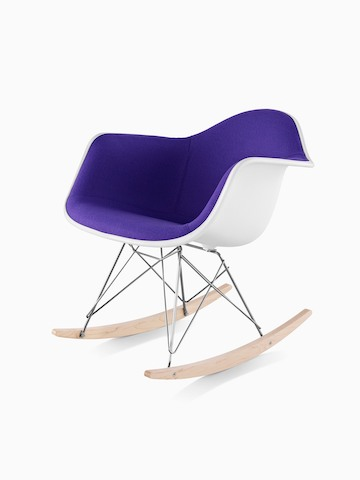 Purple upholstered Eames Molded Plastic rocking chair, viewed from a 45-degree angle.