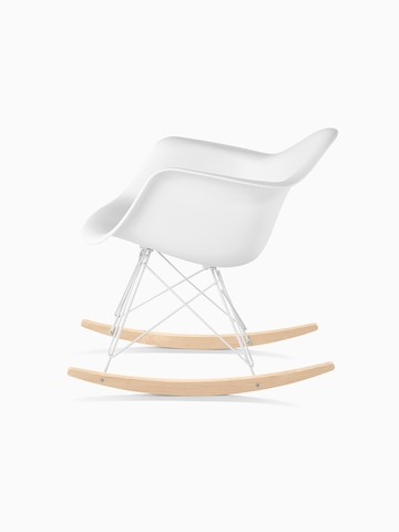White Eames Molded Plastic rocking chair, viewed from the side.