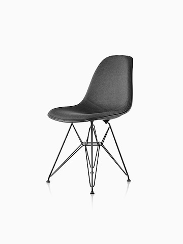 Black upholstered Eames Molded Plastic side chair with a wire base, viewed from a 45-degree angle.