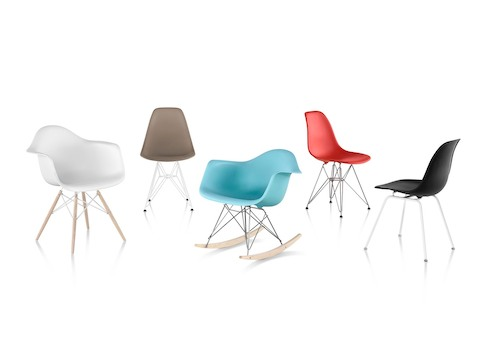 Five Eames Molded Plastic side and armchairs in white, brown, blue, red, and black, showing the various base options.