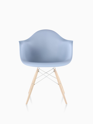 Light blue Eames Molded Plastic Chair with dowel legs.