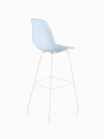Three-quarter rear view of a light blue Eames Molded Plastic Stool.