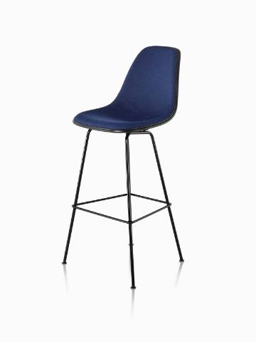 Black Eames Molded Plastic Stool with dark blue upholstery, viewed from a 45-degree angle.