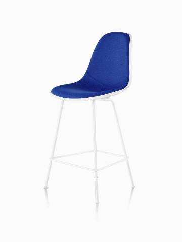 White Eames Molded Plastic Stool with blue upholstery, viewed from a 45-degree angle.