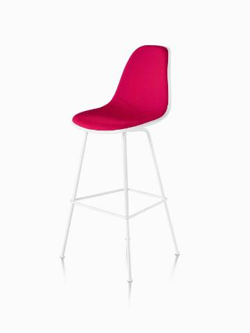 White Eames Molded Plastic Stool with red upholstery, viewed from a 45-degree angle.