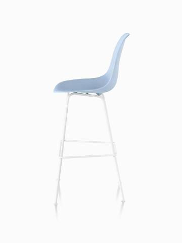 Profile view of a light blue Eames Molded Plastic Stool.