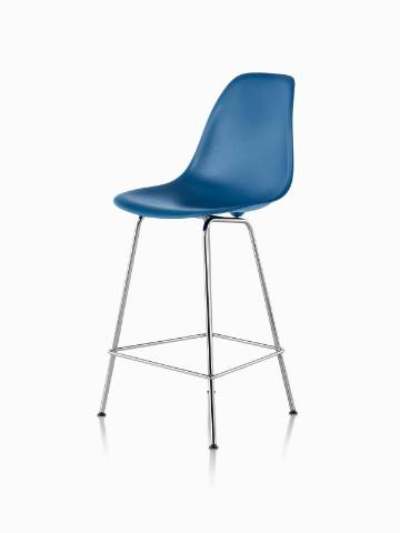 Blue Eames Molded Plastic Stool, viewed from a 45-degree angle.