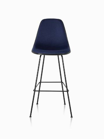 Black Eames Molded Plastic Stool with navy blue upholstery, viewed from the front.