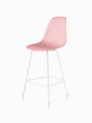 Pink Eames Molded Plastic Stool, viewed from a 45-degree angle.