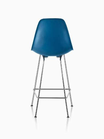 Blue Eames Molded Plastic Stool, viewed from the rear.