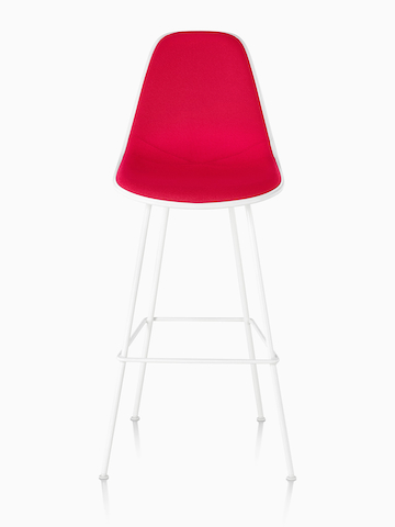 White Eames Molded Plastic Stool with red upholstery, viewed from the front.