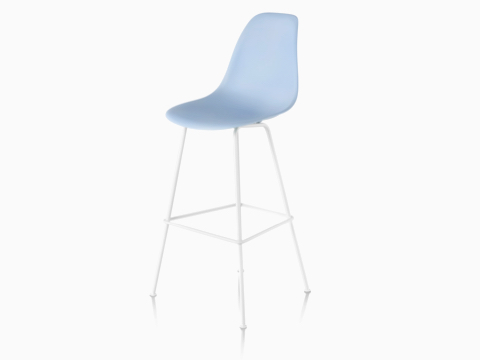 Upper half of a light blue Eames Molded Plastic Stool, viewed from a 45-degree angle.