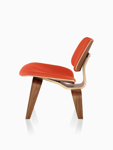 Red-upholstered Eames Molded Plywood Chair, viewed from the side.
