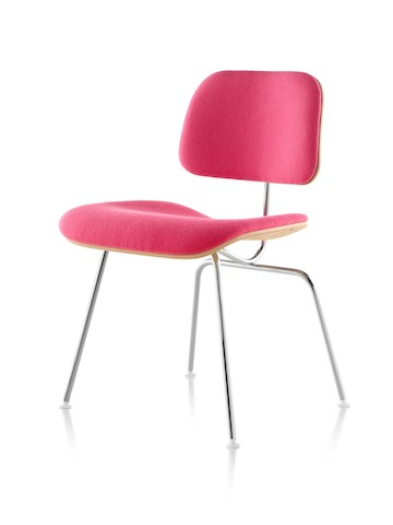 Eames Molded Plywood Chair with red upholstery and chrome-plated legs, viewed from a 45-degree angle.