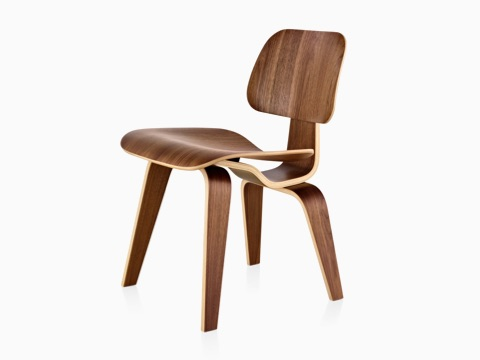 Eames Molded Plywood Chair with a medium finish and wood legs, viewed from a 45-degree angle.