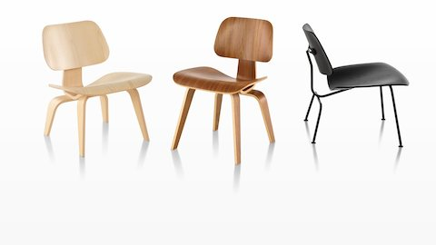 Three Eames Molded Plywood Chairs, each with a different finish.