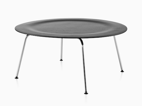 A round Eames Molded Plywood Coffee Table with metal legs and an indented top in a black finish.