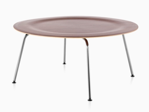 A round Eames Molded Plywood Coffee Table with metal legs and an indented top in a medium finish.