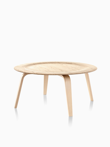 A round Eames Molded Plywood Coffee Table. Select to go to the Eames Molded Plywood Coffee Table product page.
