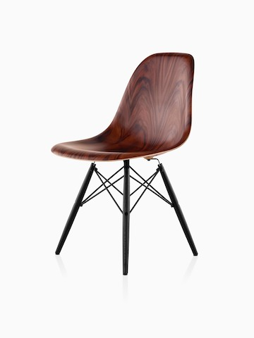 Eames Molded Wood side chair with a dark finish and dowel legs, viewed from a 45-deree angle.