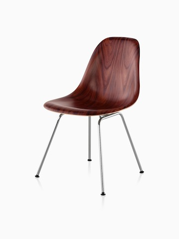 Four-leg version of an Eames Molded Wood side chair with a dark finish, viewed from a 45-degree angle.