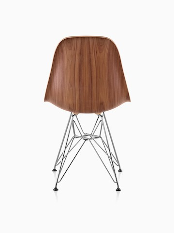 Eames Molded Wood side chair with a medium finish and wire base, viewed from the rear.