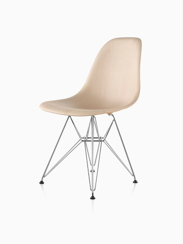 Eames Molded Wood side chair with a light finish and wire base, viewed from a 45-degree angle.