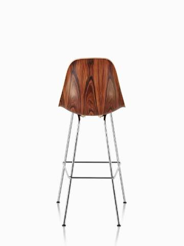 Eames Molded Wood Stool with a dark finish and silver legs, viewed from the rear.