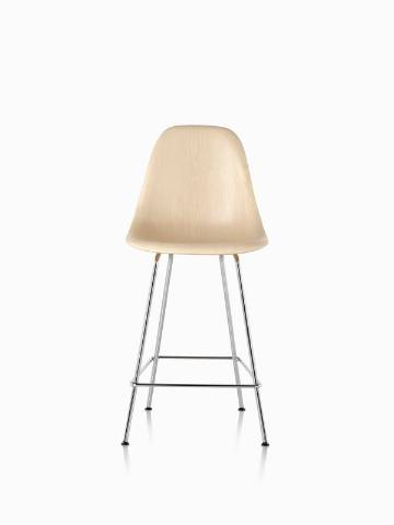 Eames Molded Wood Stool with a light finish and silver legs, viewed from the front.