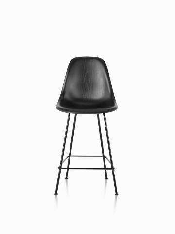 Black Eames Molded Wood Stool with black legs, viewed from the front.