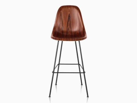 Upper half of an Eames Molded Wood Stool with a dark finish, viewed from the front.