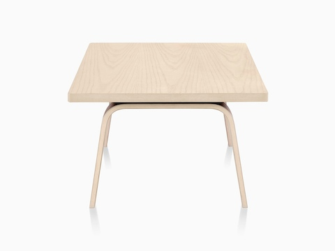 An Eames Rectangular Coffee Table With A Light Finish Viewed From The Narrow End