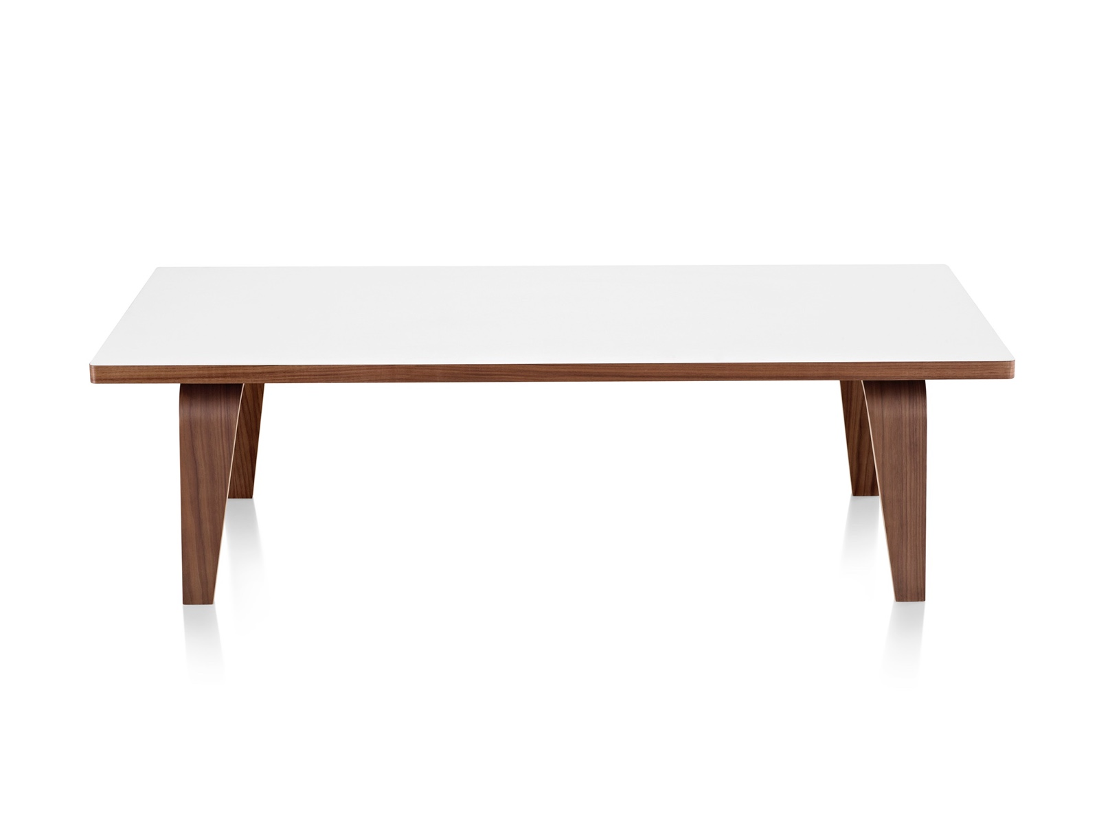 An Eames Rectangular Coffee Table with a white top and molded plywood legs in a medium finish.