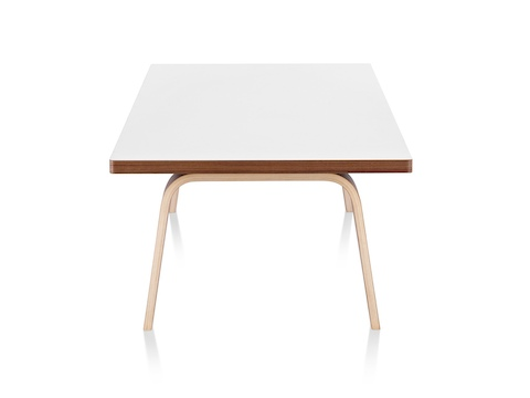 An Eames Rectangular Coffee Table With A White Top, Viewed From The Narrow  End.