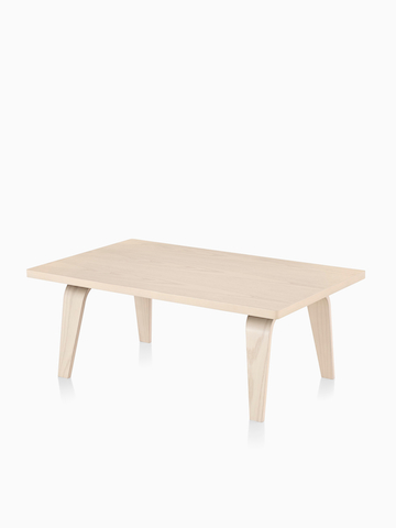 An Eames Rectangular Coffee Table with a light wood finish. Select to go to the Eames Rectangular Coffee Table product page.